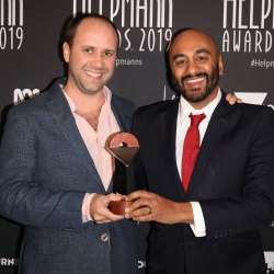 Eamon Flack and S. Shakthidharan poses with the Helpmann Award for Best Direction of a Play