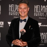 Jolyon James poses with the Helpmann Award for Best Presentation For Children And Young People for Robot Song