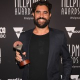 Jacob Nash poses with the Helpmann Award for Best Regional Touring Production