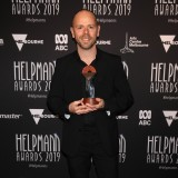 Antony Hamilton poses with the Helpmann Award for Best Choreography in a Ballet, Dance or Physical Theatre Production
