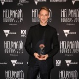 Mitchell Woodcock poses with the Helpmann Award for Best Choreography in a Musical