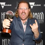 Brent Hill poses with the Helpmann Award for Best Male Actor in a Musical for School of Rock the Musical.