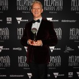 Michael Honeyman poses with the Helpmann Award for Best Male Performer in an Opera for Wozzeck.