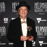 Brian Ritchie poses with the Helpmann Award for Best Contemporary Music Festival - Museum of Old and New Art (Mona) for MONA FOMA 2019.