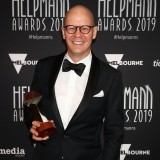 Evan Kennea poses with the Helpmann Award for Best Symphony Orchestra Concert for Tristan und Isolde by West Australian Symphony Orchestra.