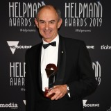 Ian Scobie poses with the Helpmann Award for Best Opera for Komische Oper Berlin's The Magic Flute by Arts Projects Australia, Adelaide Festival and Perth Festival.